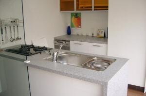Искусственный камень Tristone в интерьере кухни